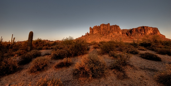 Sun setting on the superstition mountains in Arizona