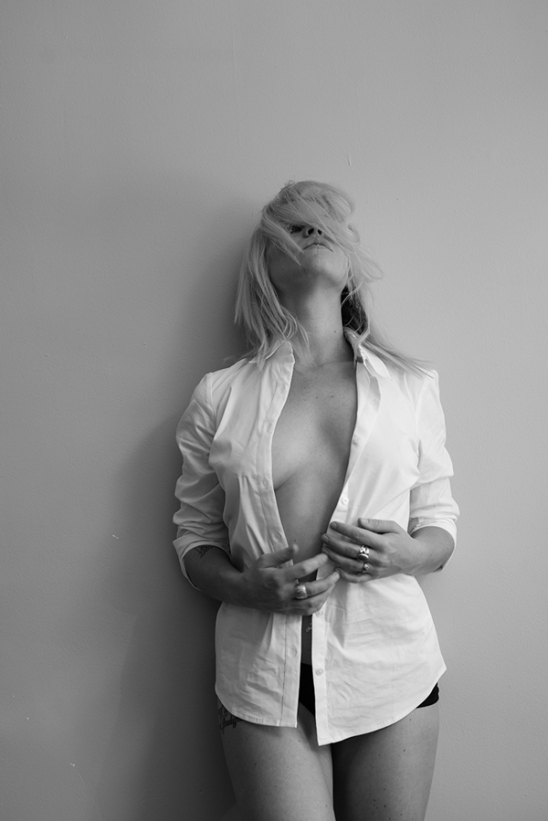 Sexy blonde Model in unbuttoned shirt